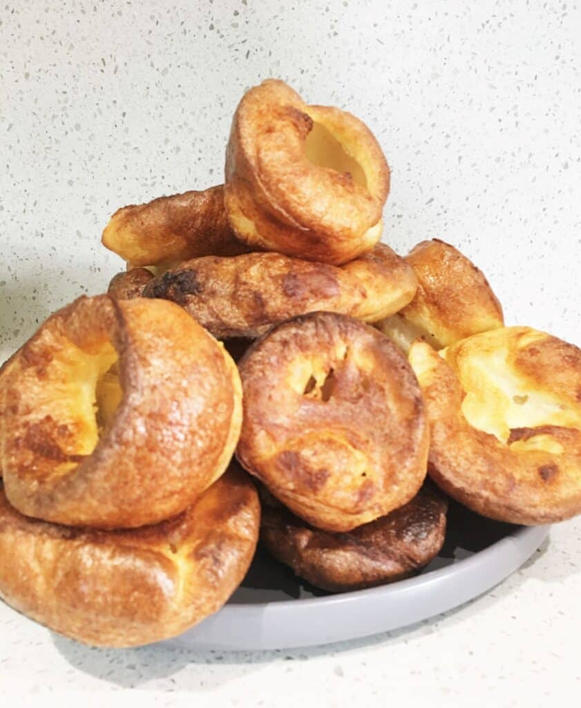 Plate piled with Yorkshire pudding