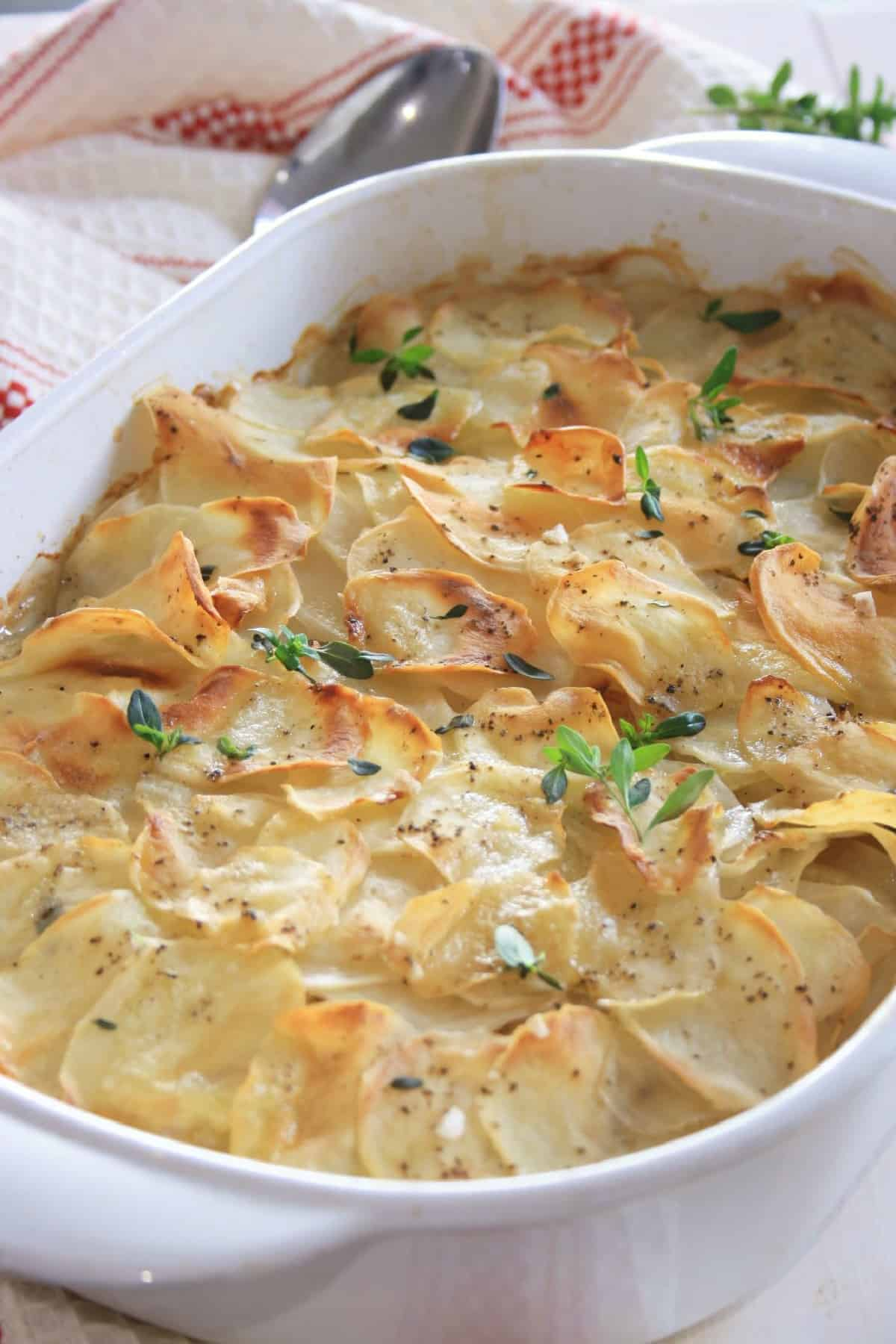 cooked potato bake with a spoon to the side of the dish.