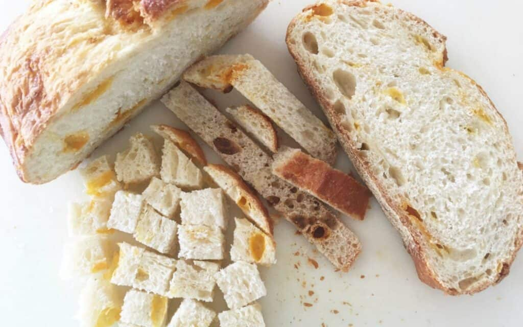 sliced and cubed bread from a loaf