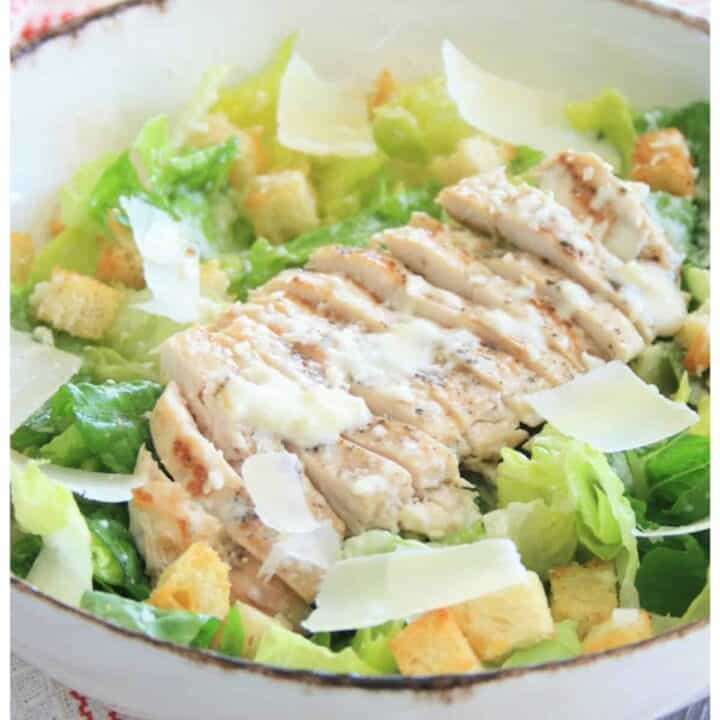 close up of sliced chicken on lettuce