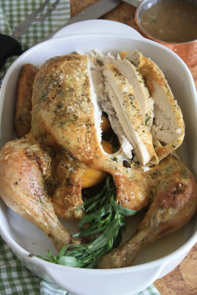 whole roast chicken with slices cut