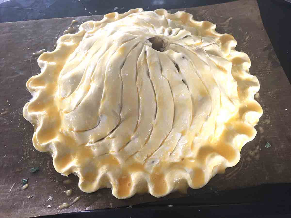 pie top in place, glazed and withcurved lines  carved into it.