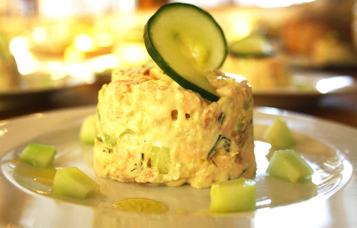 close up of salmon timbale with cucumber.
