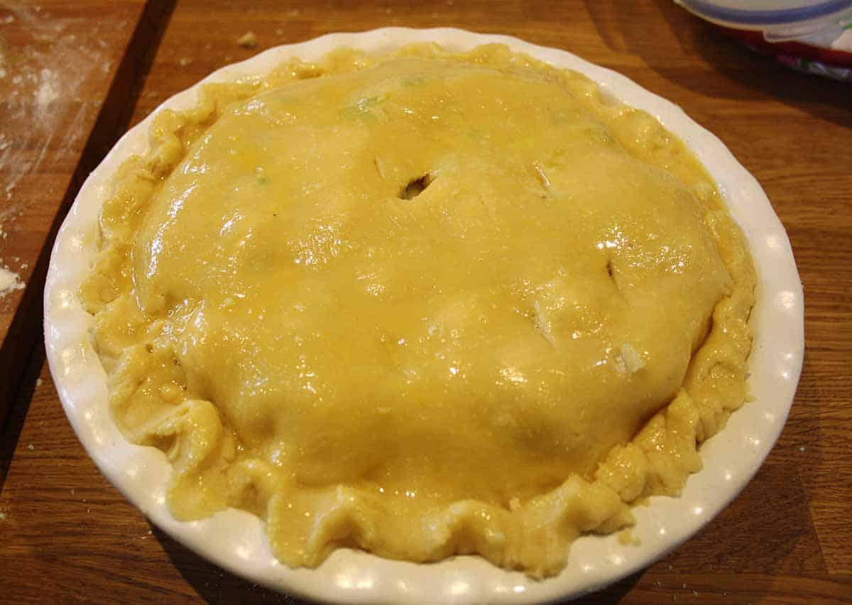Pie with glazed top crust.
