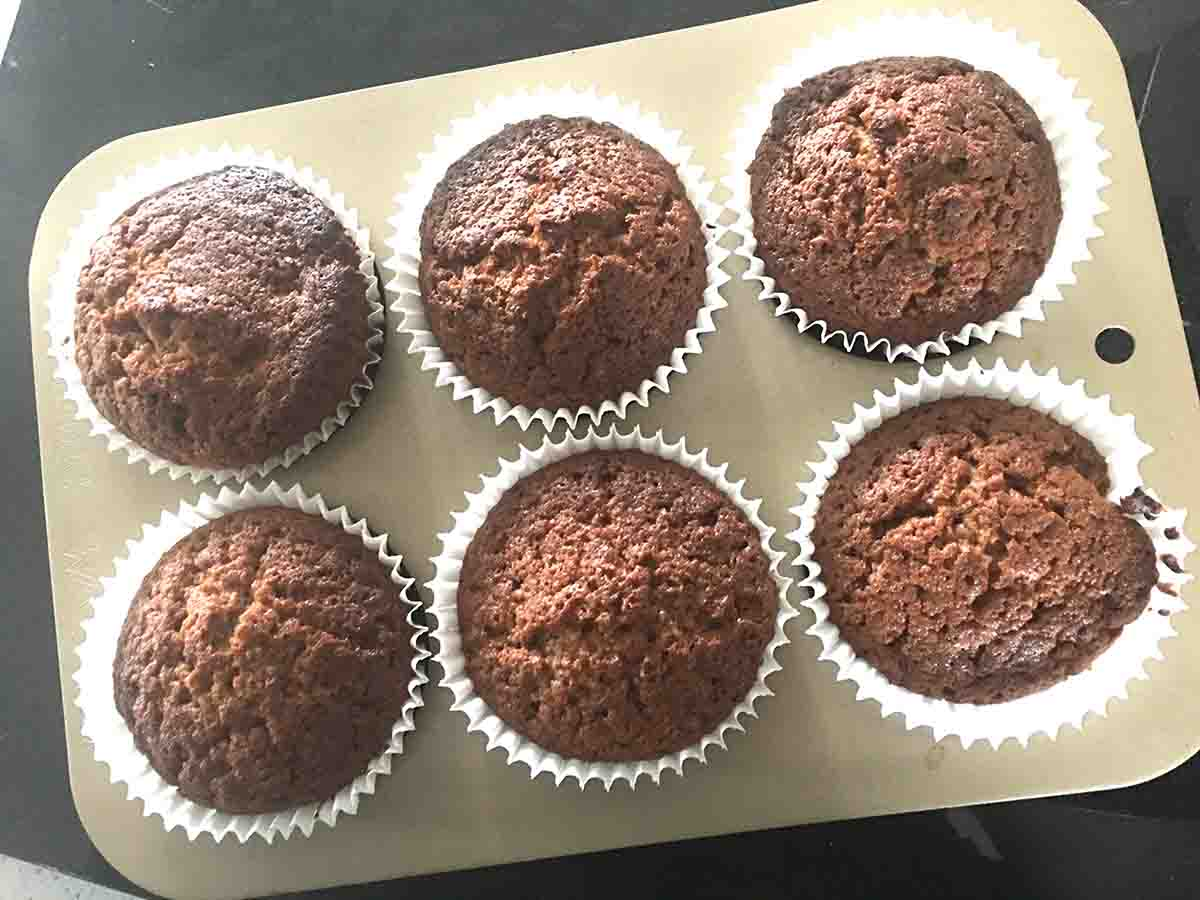 cooked muffins in the tin.