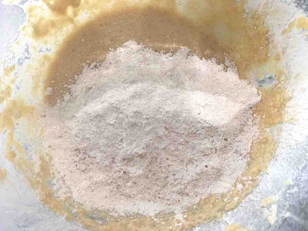 flour added to cake mixture.