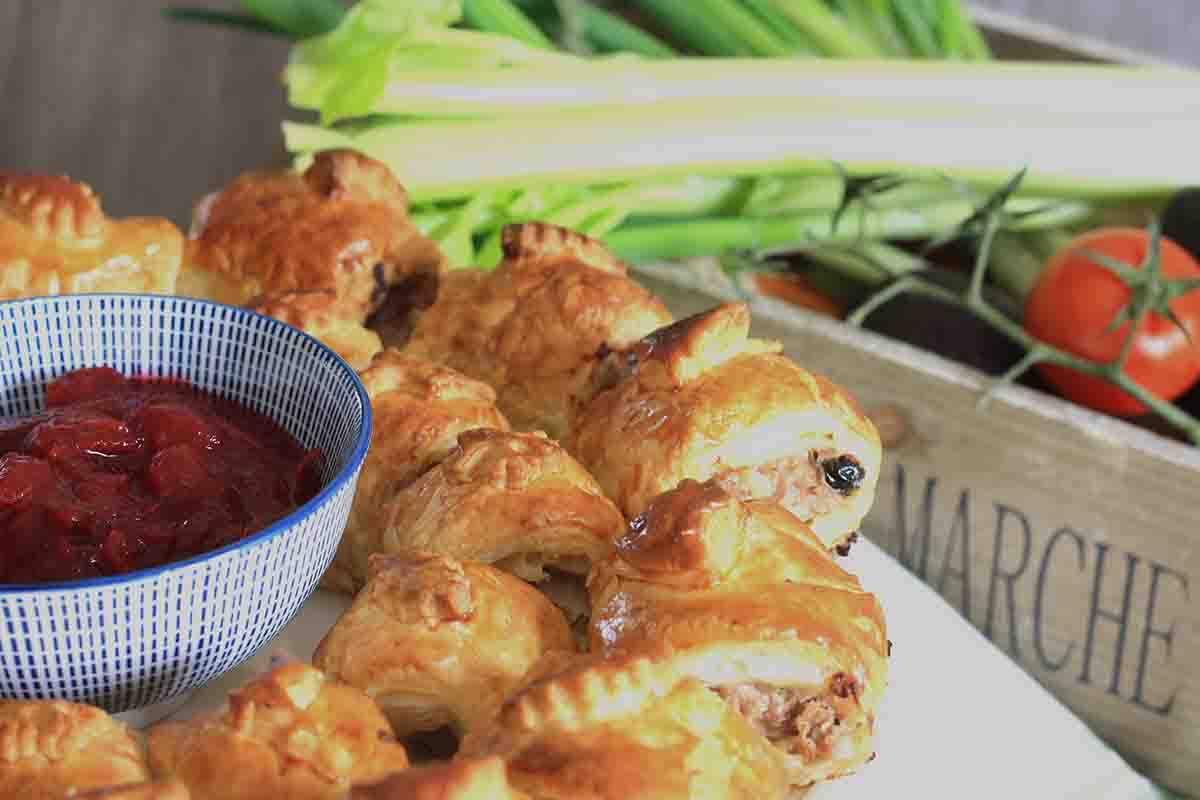 sausage rolls on a plate.
