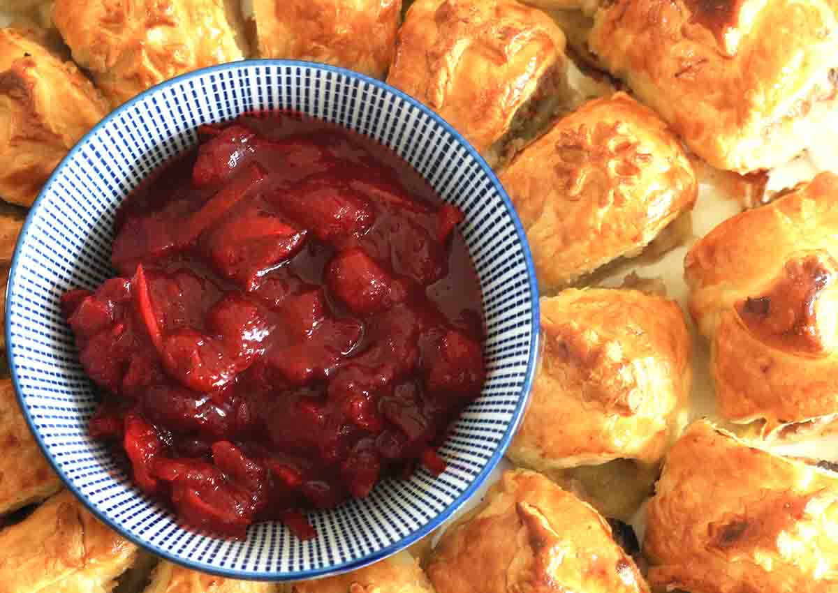 overhead view of turkey and cranberry sausage roll wreath.