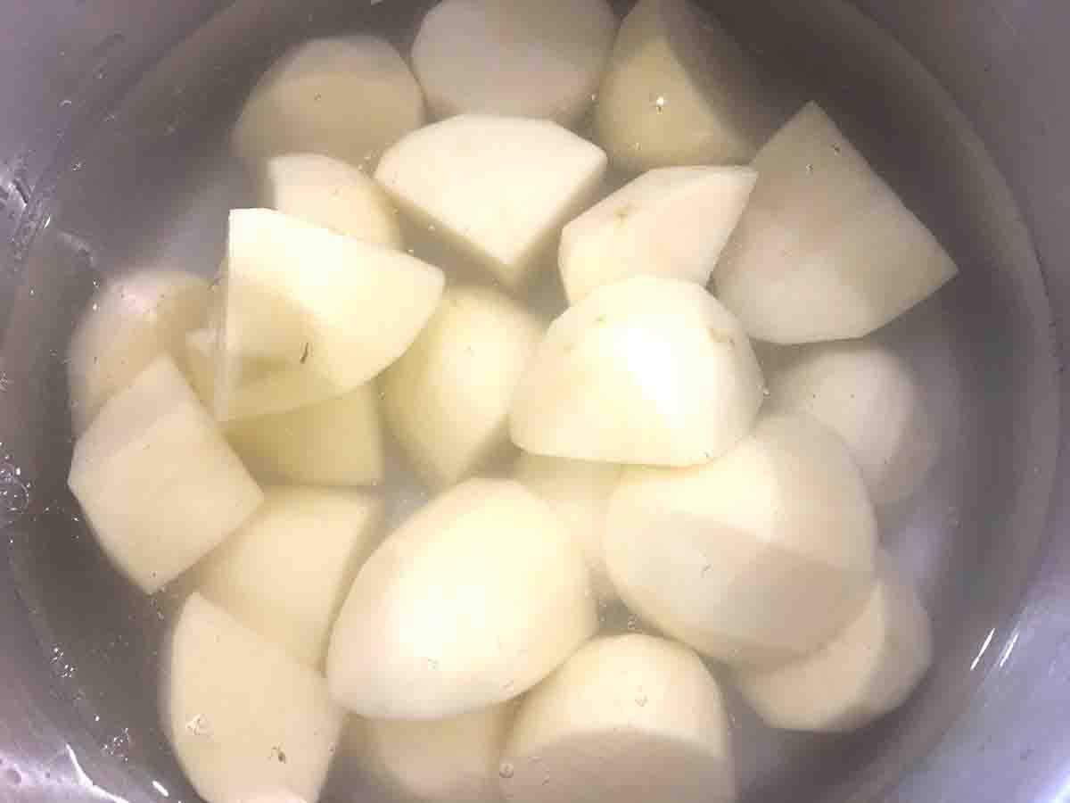 cut potatoes in water in a saucepan.