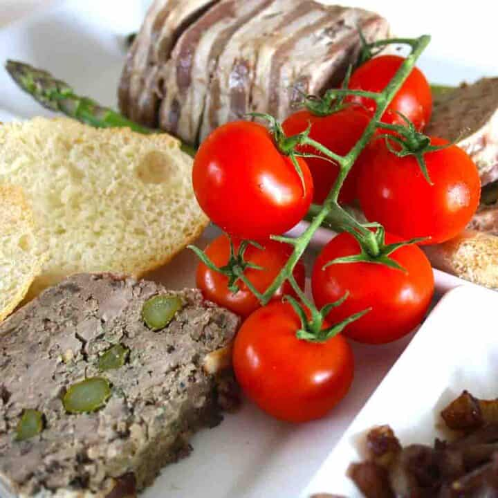 slices of duck terrine with tomatoes and onion chutney.
