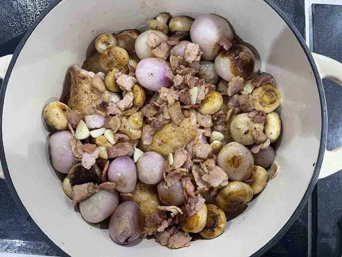 browned onions and shallots added to the casserole pan with chicken.