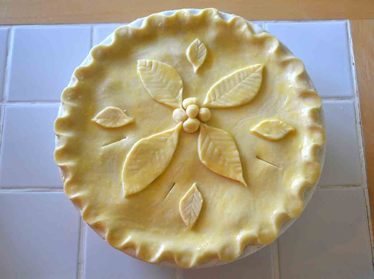 pie dish covered with pastry and leaf cut outs.