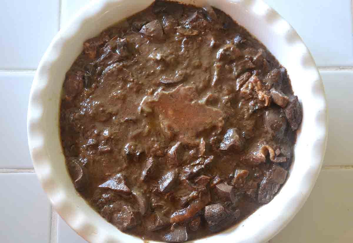 meat mixture in a pie dish.