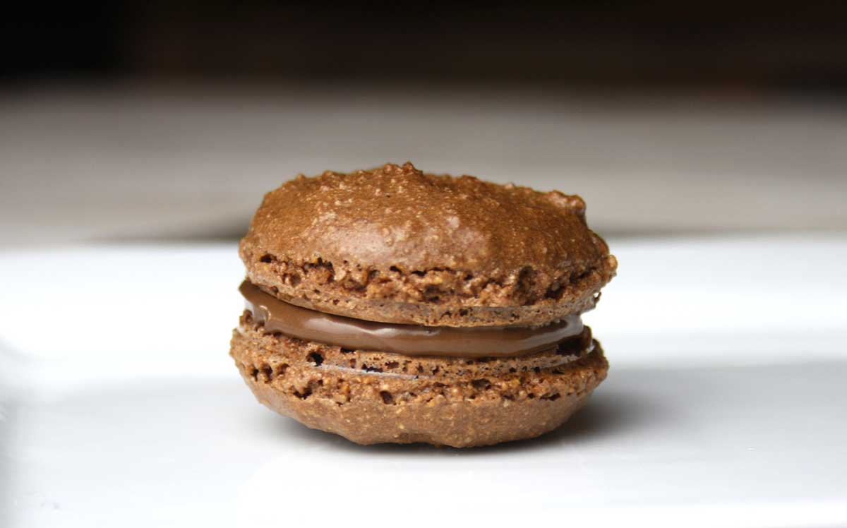 close up of a Nutella macaron.
