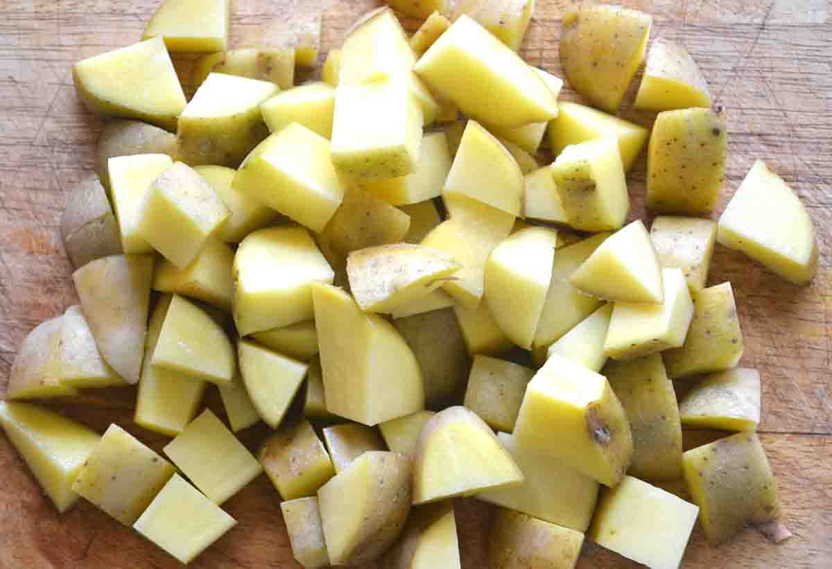 cubed potatoes on a board.