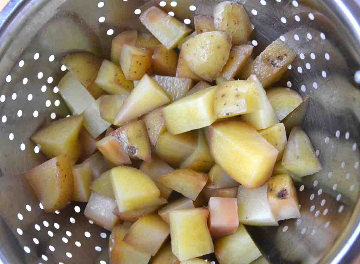 diced potatoes in a colander.