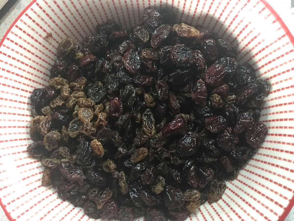 dried fruit in a bowl soaking in tea.