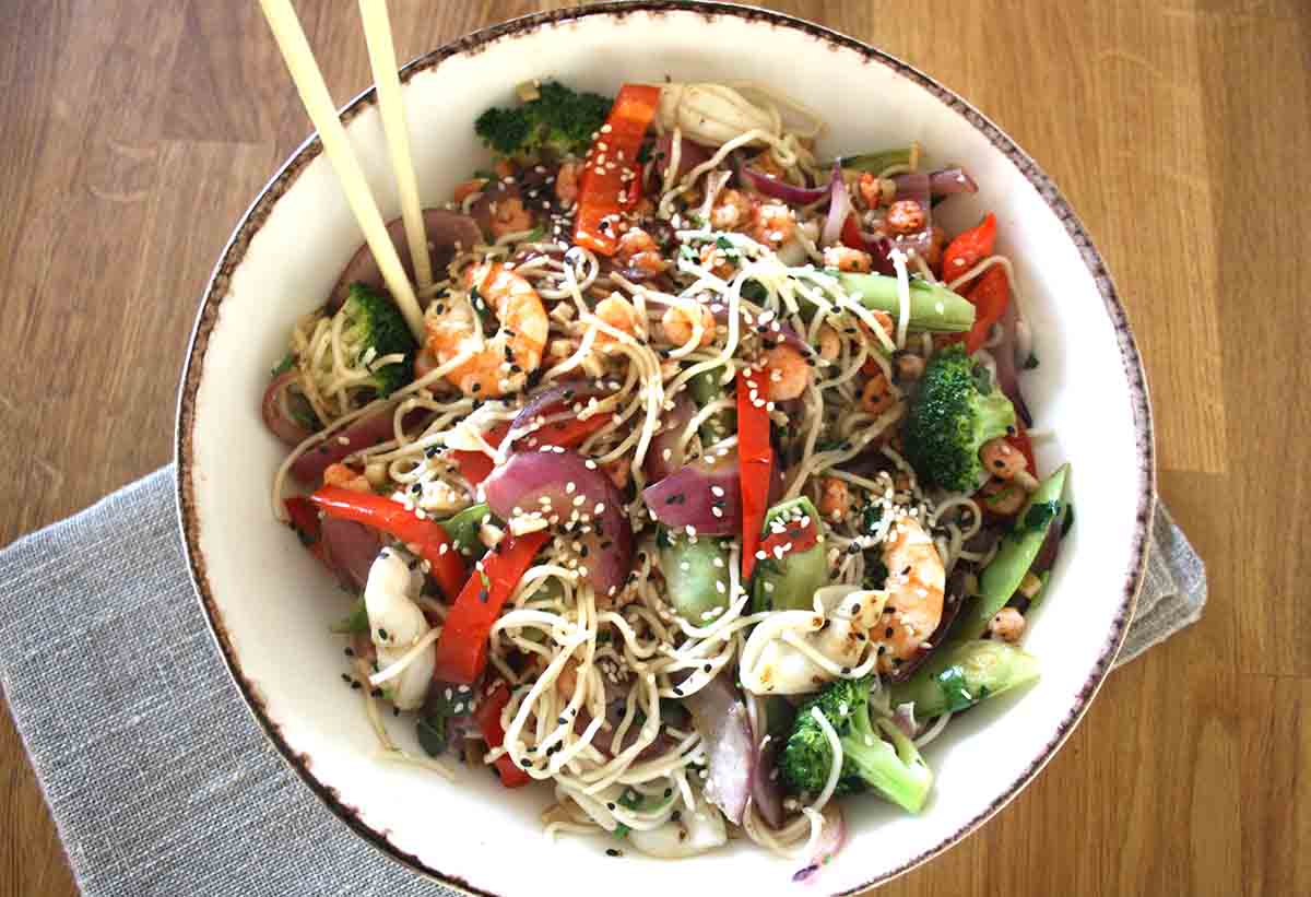 bowl of vegetable noodles with prawns and squid.