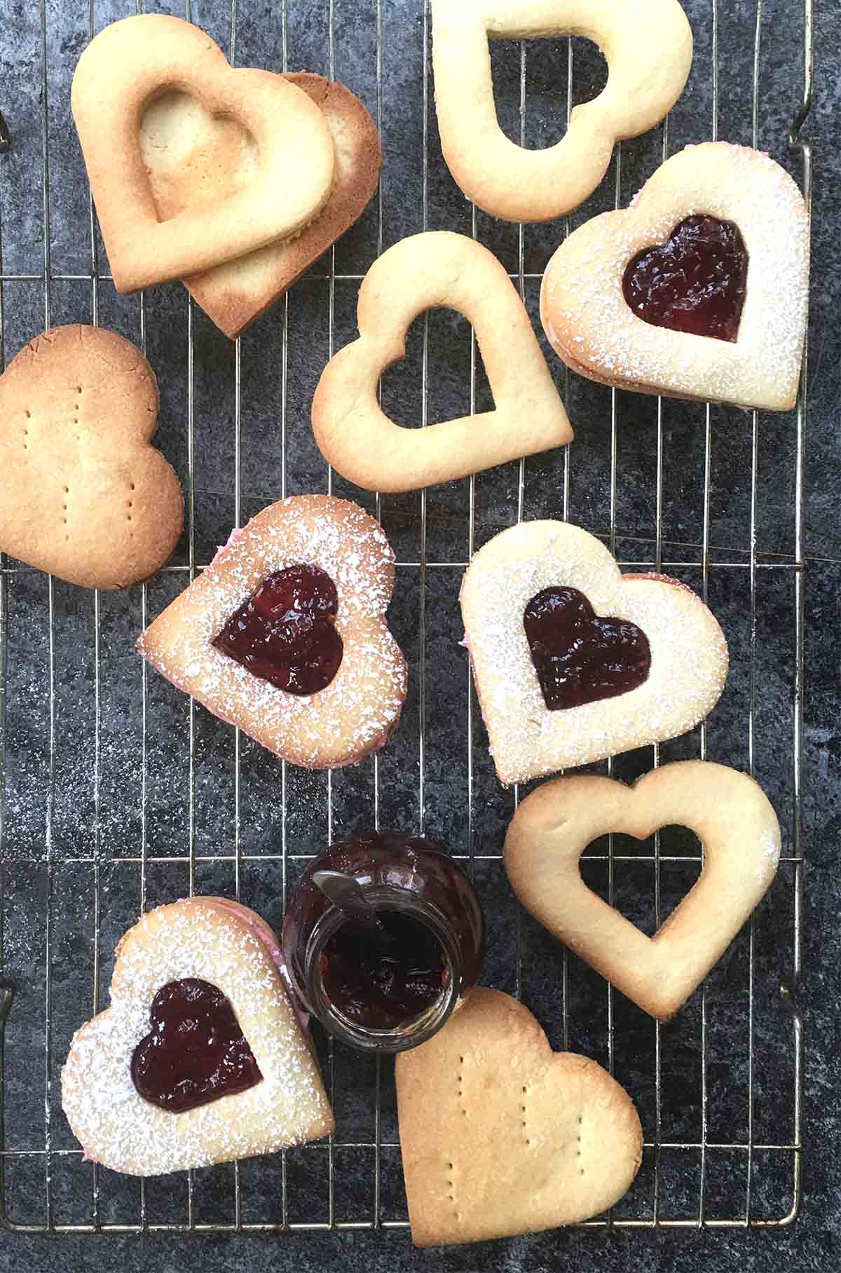 raspberry almond linzer cookies on a  baking rack  for the Valentine's day menu.