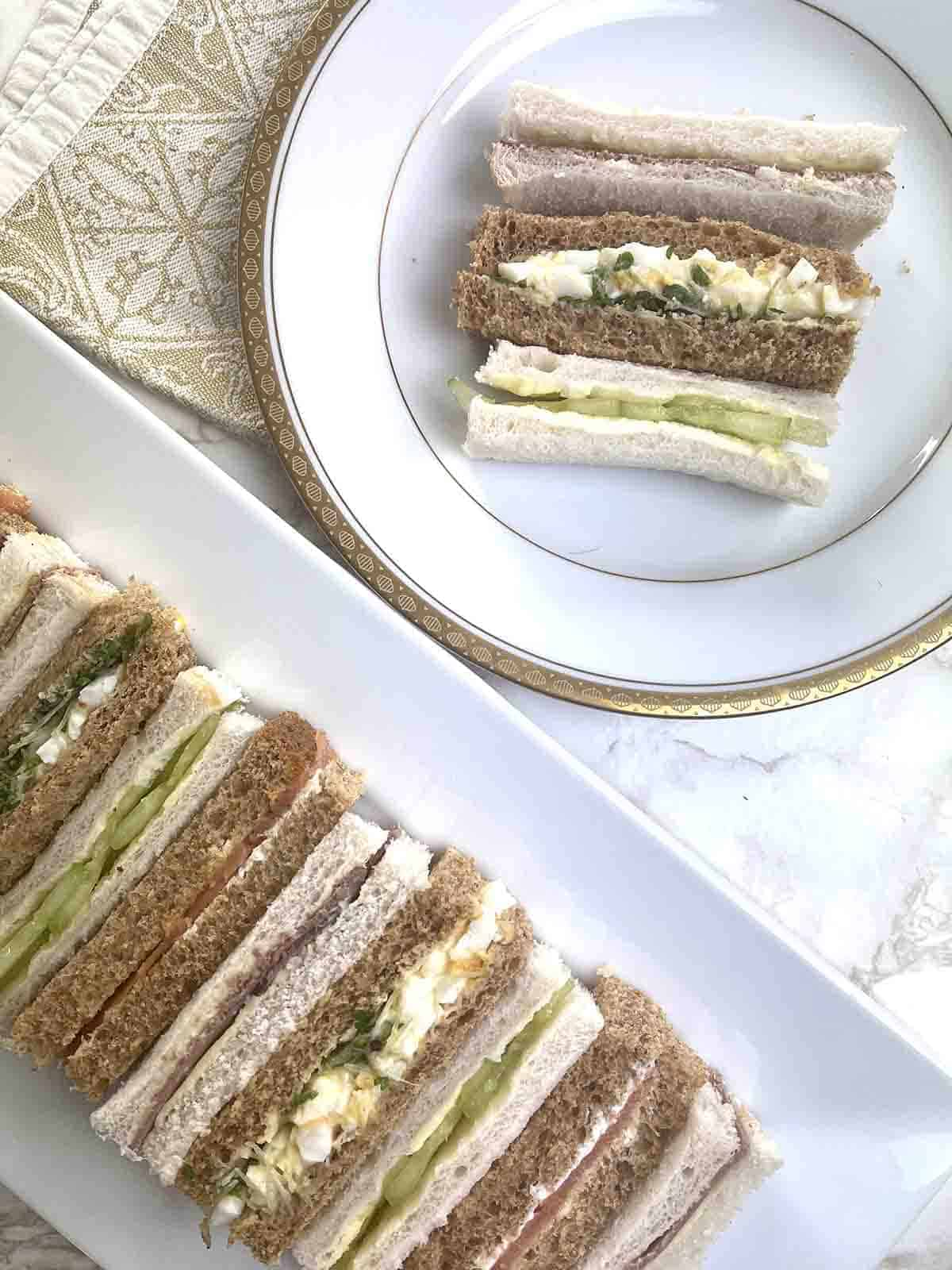 afternoon tea sandwiches on a plate.