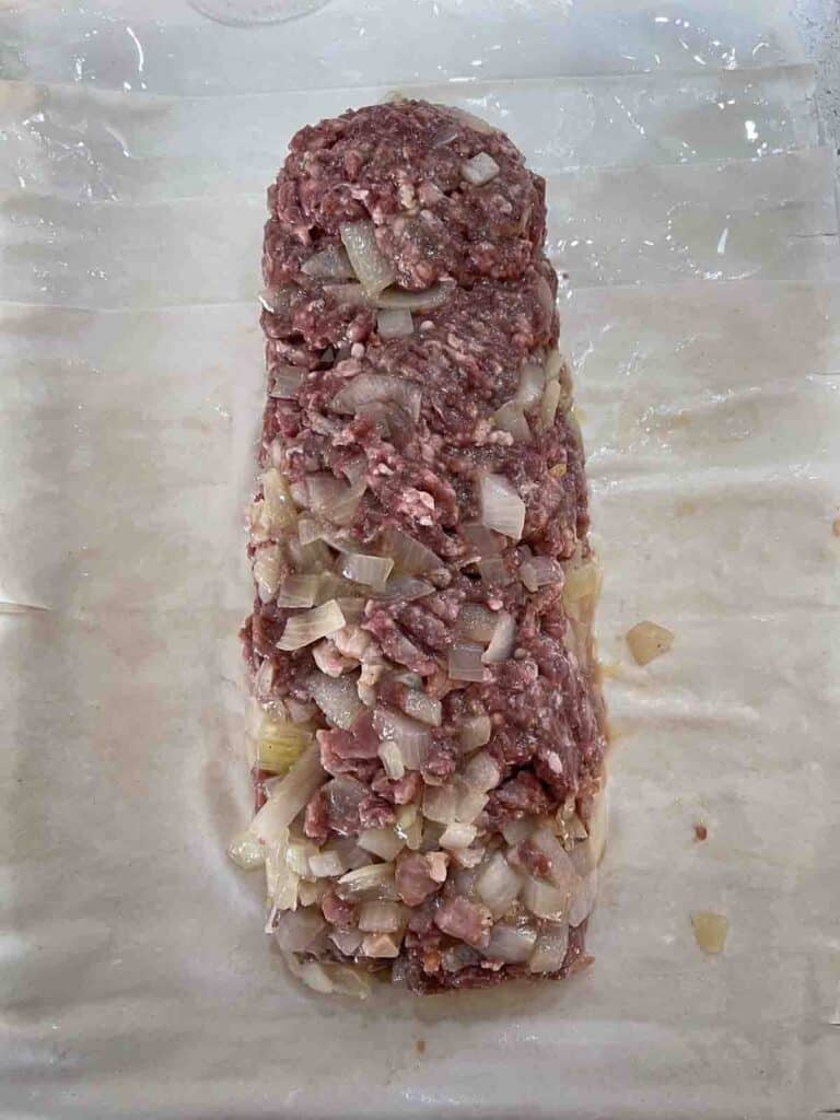 venison mince mixture in a sausage on sheets of filo pastry.