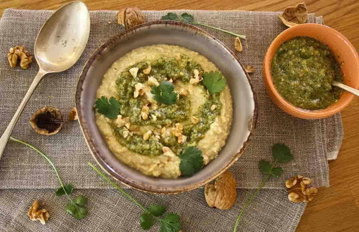 bowl of hummus and coriander pesto.