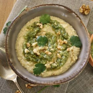 hummus with coriander pesto in a bowl.