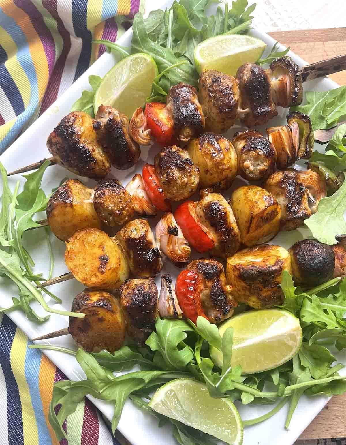 sausage kebabs on a plate.