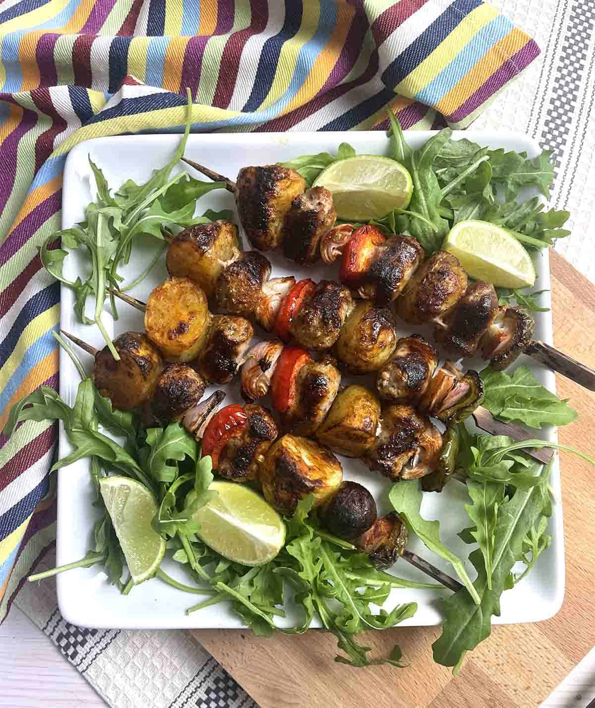 Lincolnshire sausage skewers on a plate.