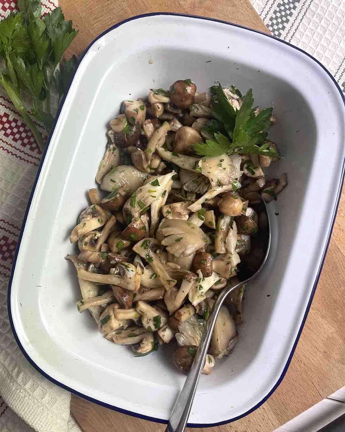 raw mushroom salad in a serving dish.