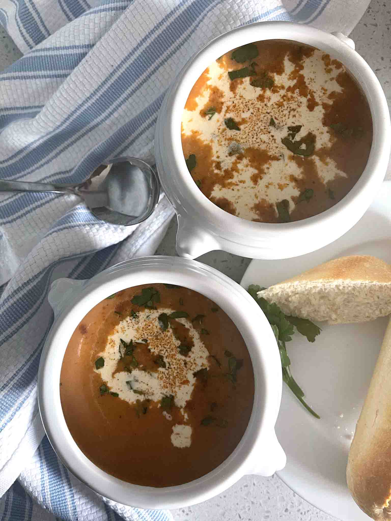 two bowls of shellfish bisque soup.
