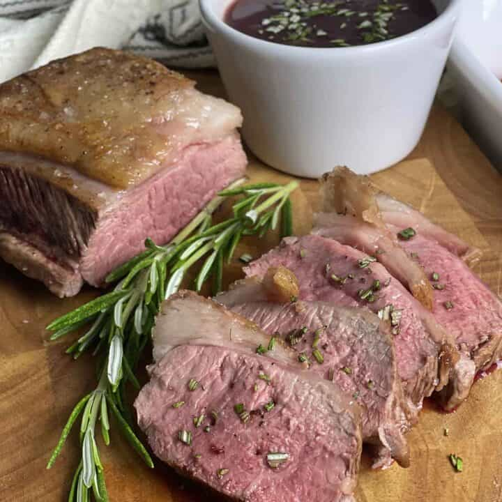 slices of cannon of lamb and redcurrant sauce in a pot.
