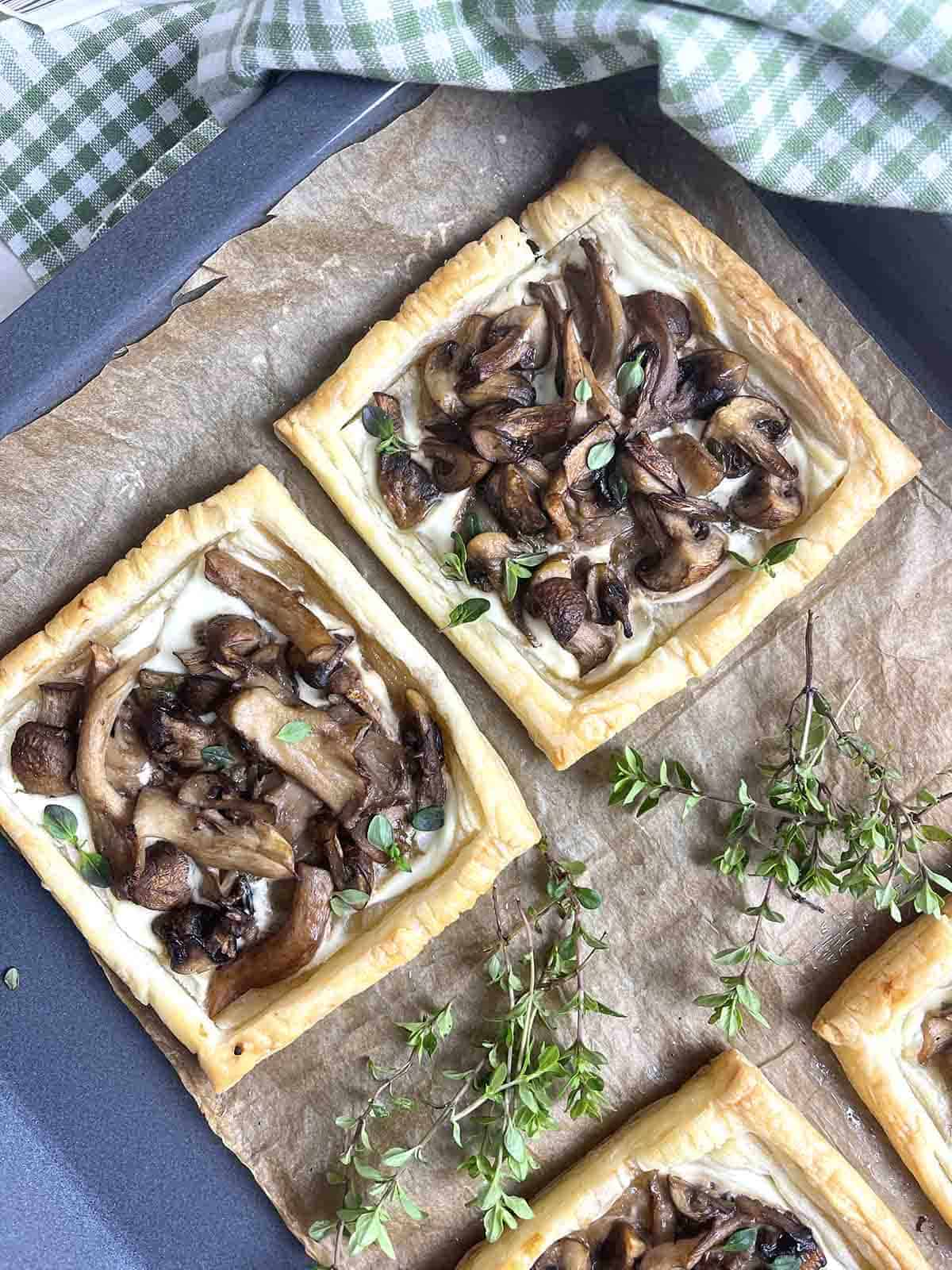 cooked tarts on a baking sheet.