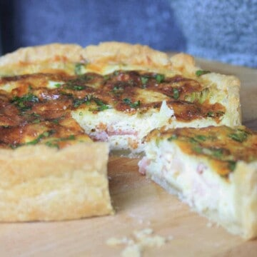 French quiche lorraine flan with a slice cut out.