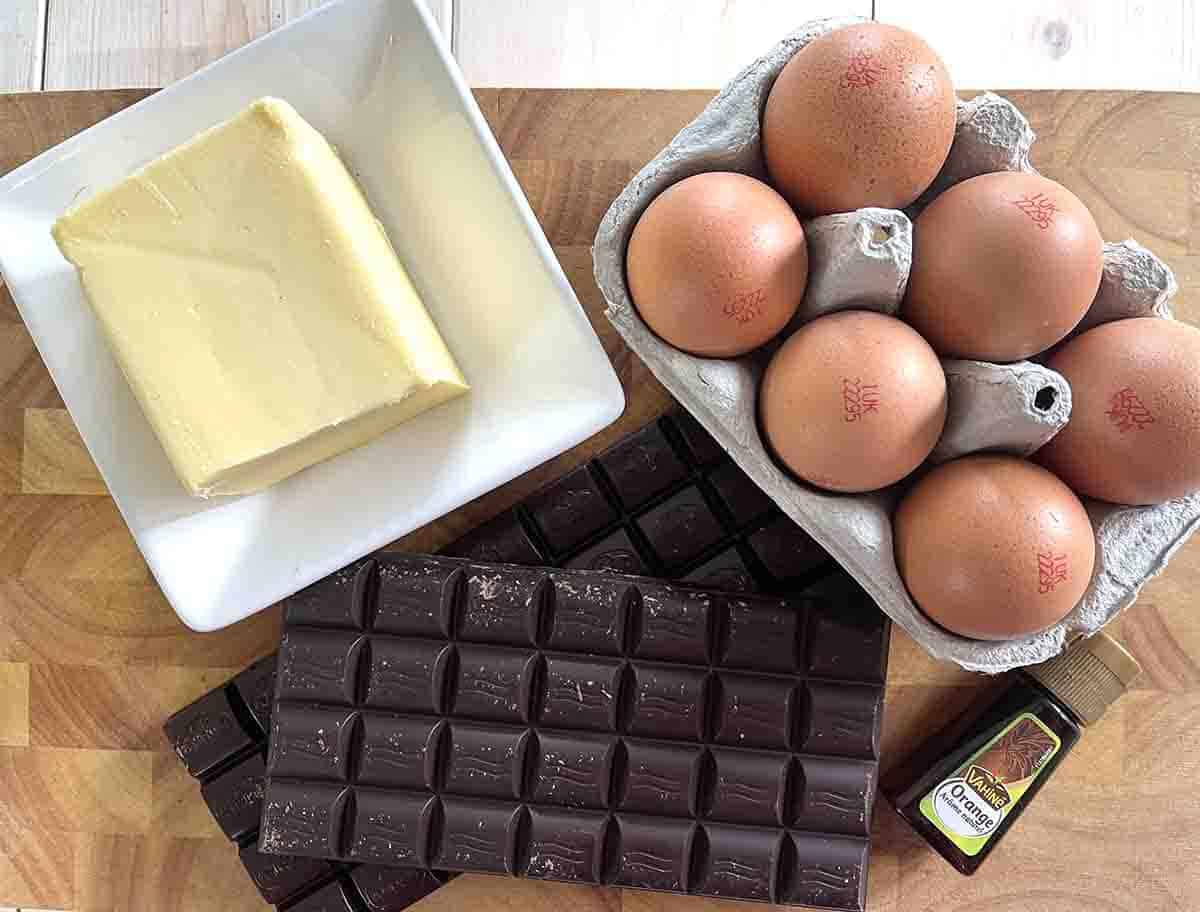 chocolate, eggs and butter on a board.
