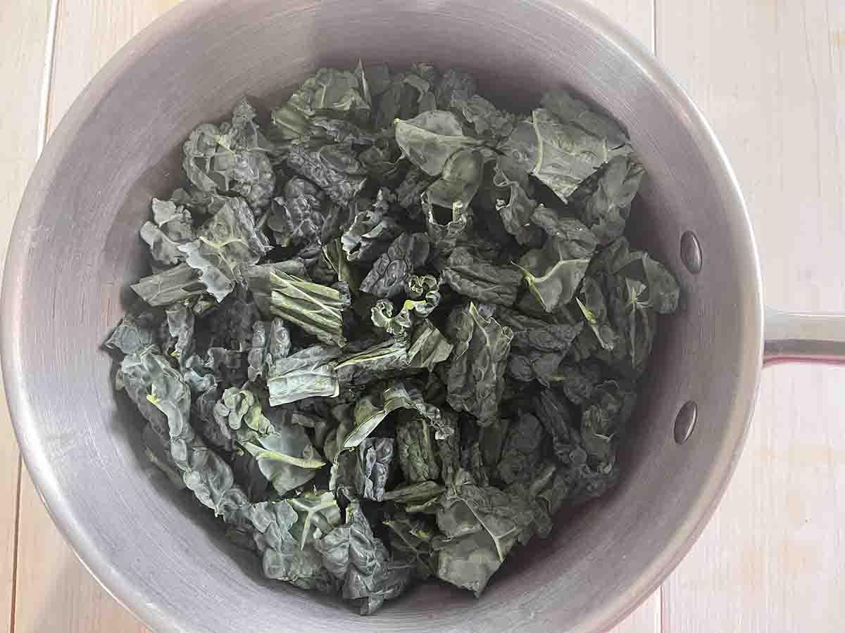 chopped kale in a saucepan.