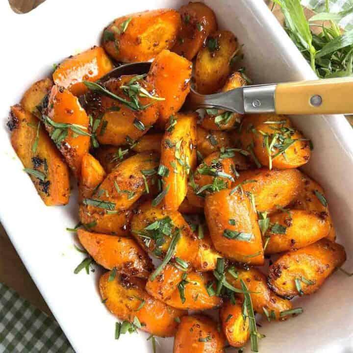 honey glazed carrots in a white dish.
