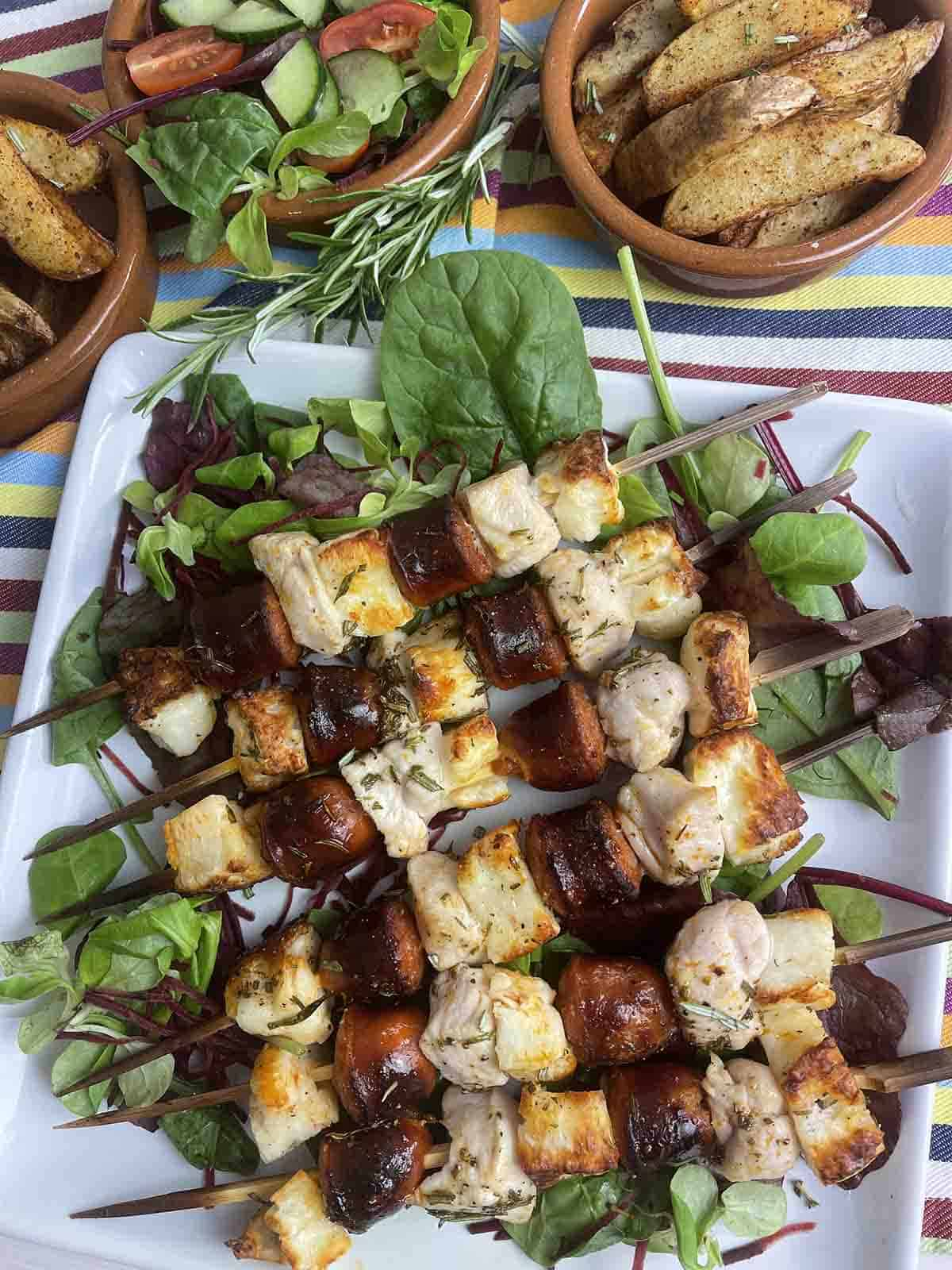 halloumi skewers with chicken and chorizo on a plate.