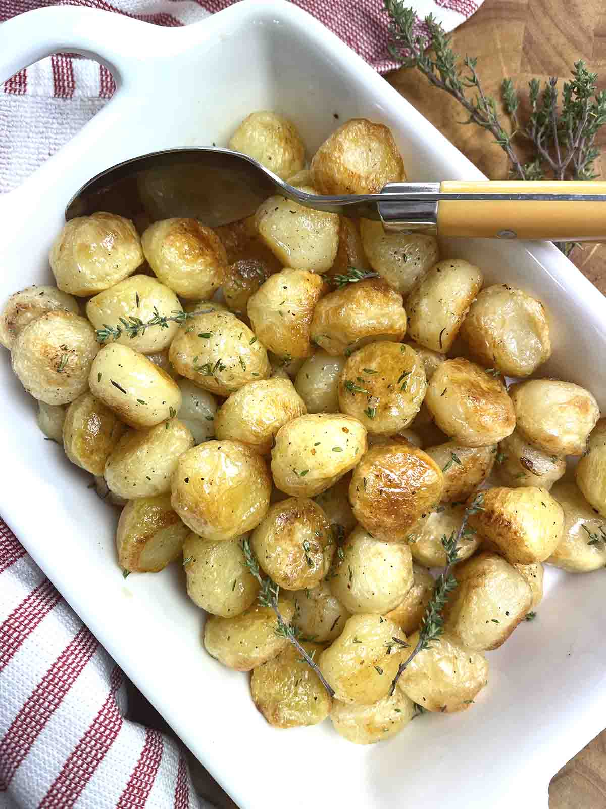 noisette potatoes in a serving dish.